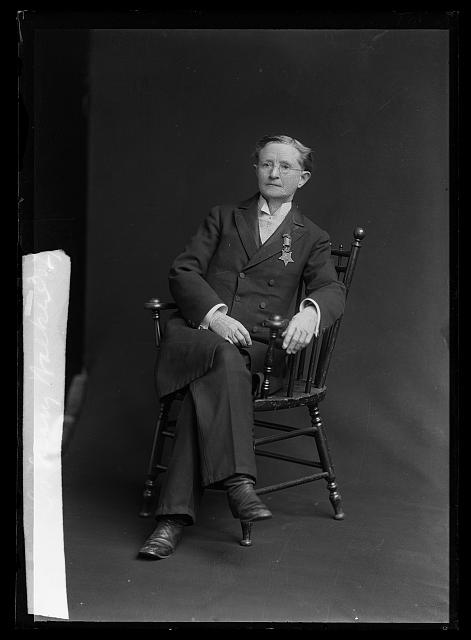 Dr. Mary Walker sitting for a photograph wearing her Medal of Honor